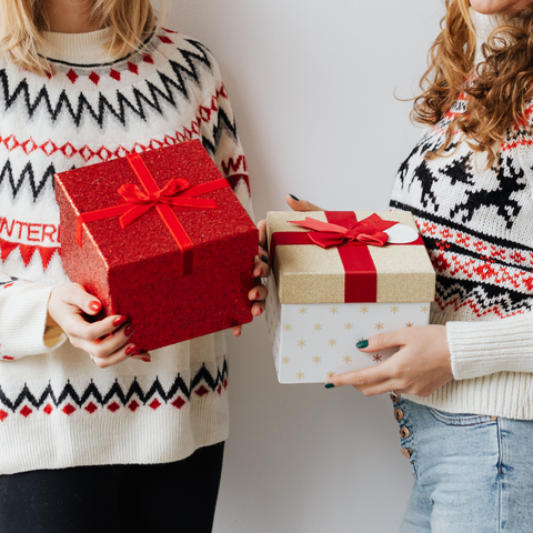 Personalised Gifts for friends - Two best friends holding Christmas gifts