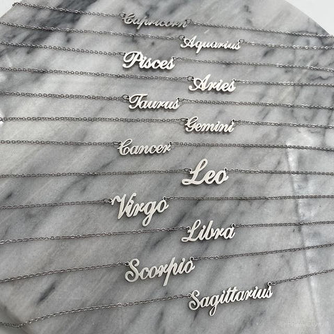 silver zodiac name necklaces