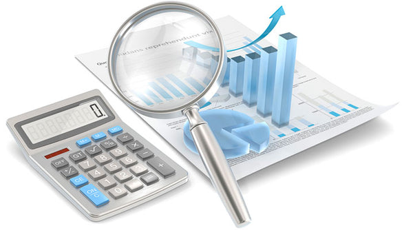 Image of calculator, bar chart and magnifying glass