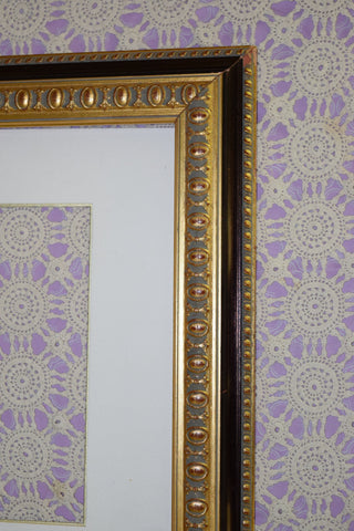 Frame, brass with black accents ornate