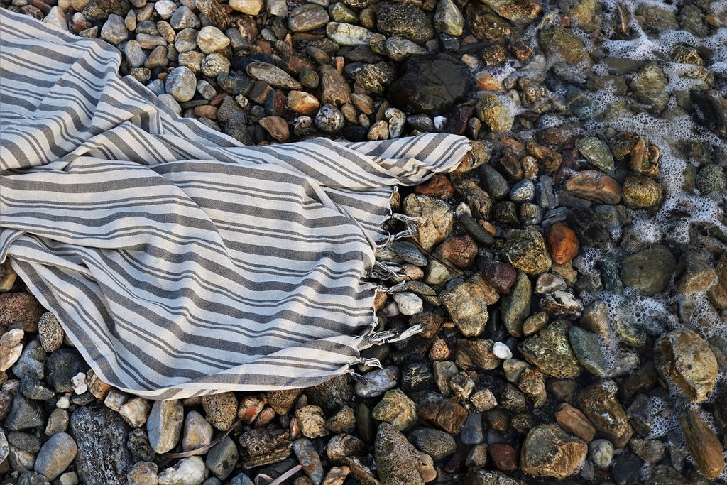 Turkish towels on pebble beach