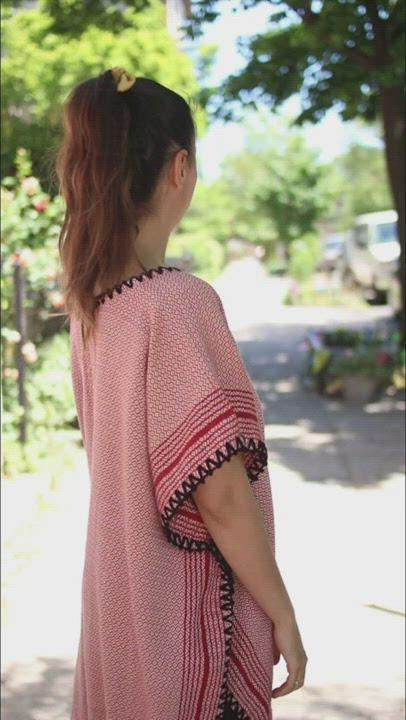 Derya walking around in a red matia kaftan