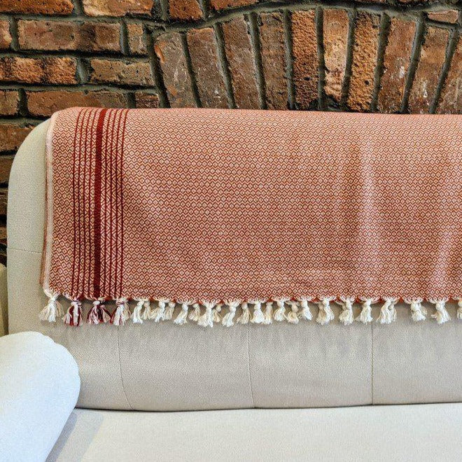 MATIA Red Blanket Scarf across white couch - anatolico