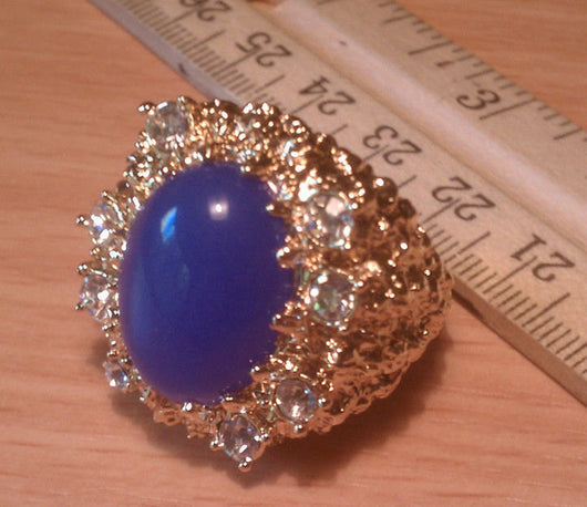 Close up of Blue Lapis Tribute Ring with ruler.