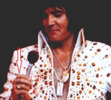 Elvis Presley wearing his lion claw necklace