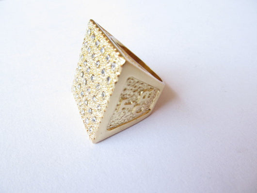 Side view of the Golden Pyramid T.C.B. Ring.