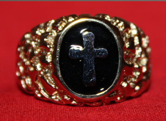 Close up of the face of the Golden Cross Ring.