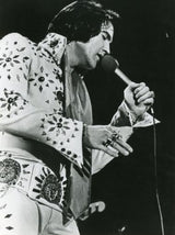 Elvis Presley and his bling.