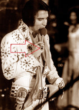 Elvis wearing his golden nugget ring.