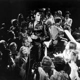 Elvis surrounded by his fans.