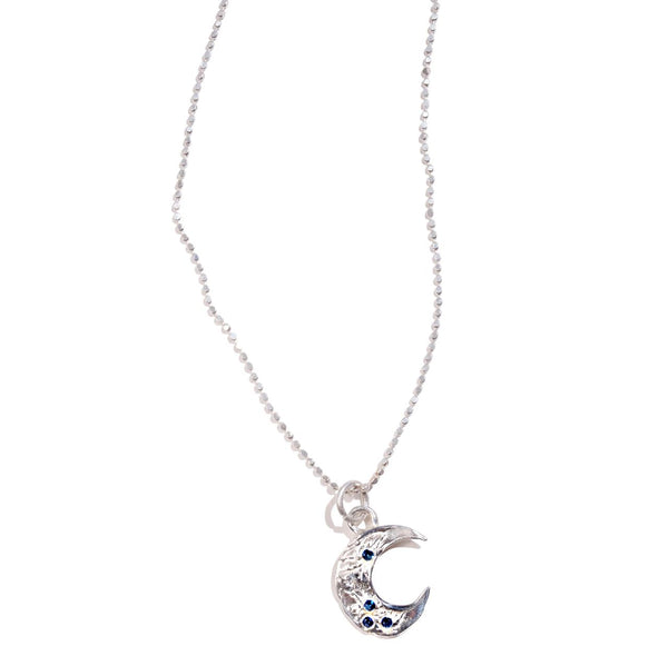 Crescent Moon Pendant (available in gold or silver)