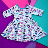 Dinosaur clothes for girls dinosaurs twirl dress with pockets girl clothing twirly pocket dresses science stem paleontology girly pink purple kids pants toddler shirt t-shirt birthday dino party theme gift baby children's child infant nerd geek nerdy geeky ethical fashion brand style scientist smart smarty pima cotton Peru outfit apparel Kansas company mom-owned circle skirt ballet flat lay photography colorful skater