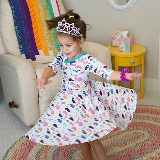Dinosaur clothes for girls dinosaurs twirl dress with pockets girl clothing twirly pocket dresses science stem paleontology girly pink purple kids pants toddler shirt t-shirt birthday dino party theme gift baby children's child infant nerd geek nerdy geeky ethical fashion brand style scientist smart smarty pima cotton Peru outfit apparel Kansas company mom-owned circle skirt ballet skater