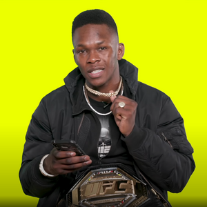 Israel Adesanya wearing our Yellow Gold Diamond Cuban Link Chain in 12mm - The Jewelry Plug