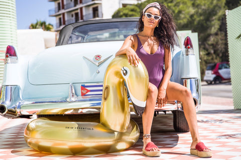 Farrieda Smit with Inflatable Golden Swan Swim Ring Large on the car
