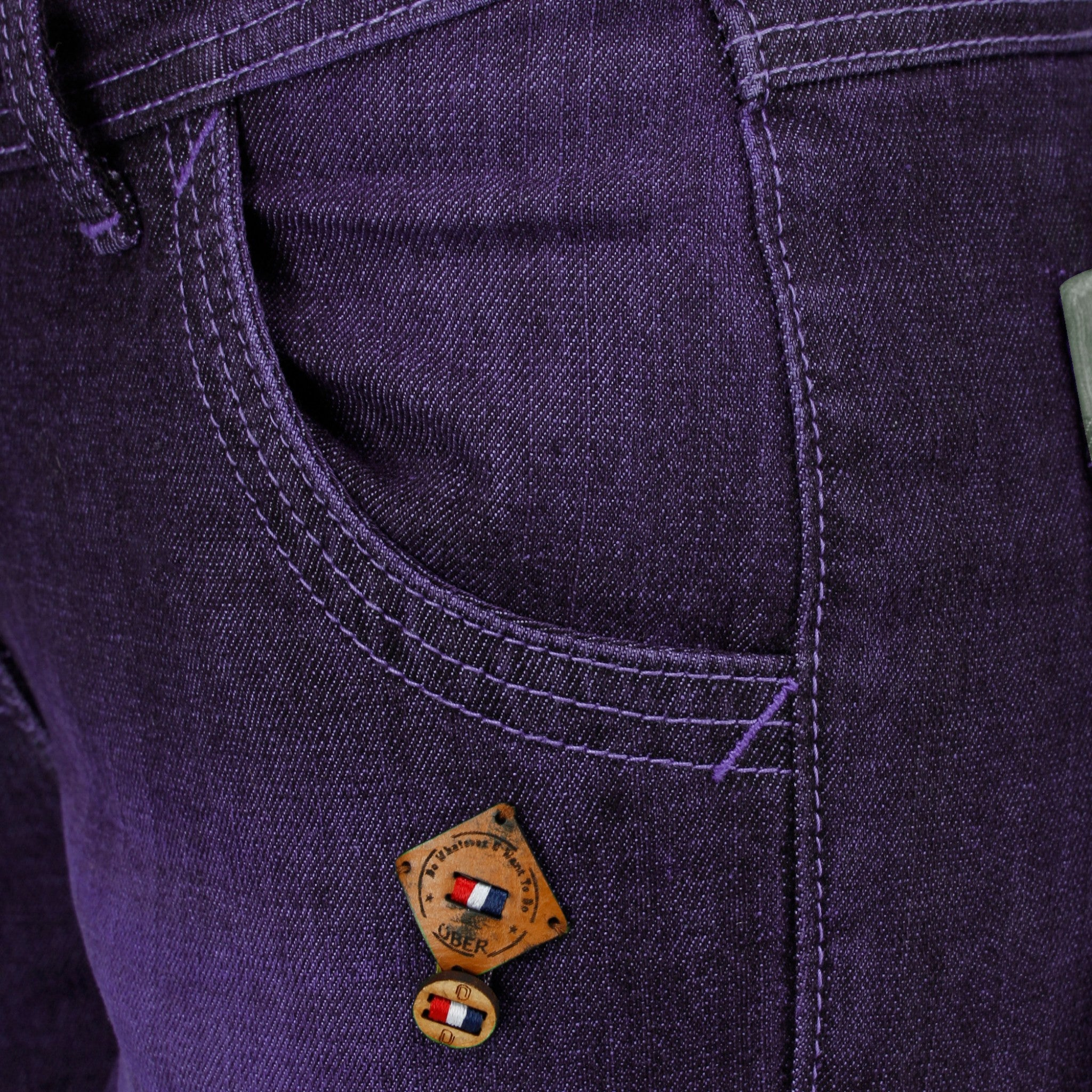 Magenta Denim Capri close up view of front pocket