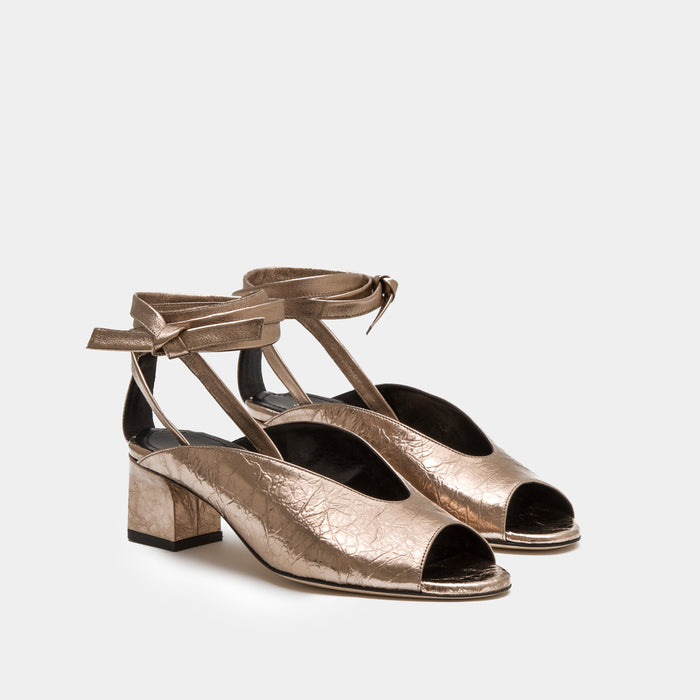 Bronze metallic nappa peep toe mule with an ankle tie wrap block heel
