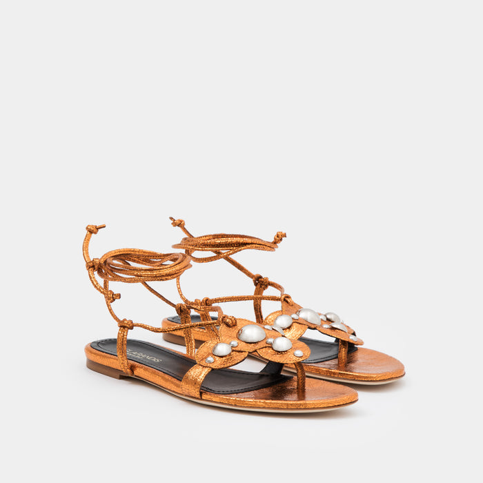 Copper crinkle metallic oversized studded flat thong with an ankle-tie