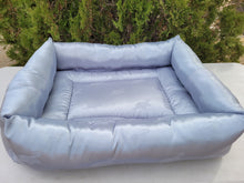 Large satin bed