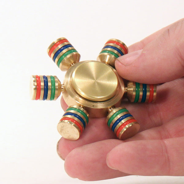The Zeekio Pinwheel Fidget Hand Spinner- Solid Brass with Hybrid Bearing