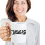 A Balanced Diet Means a Cupcake in Each Hand Funny Mug
