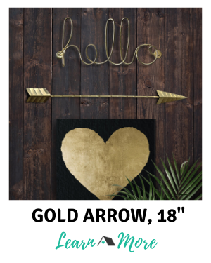 single gold arrow wall decor