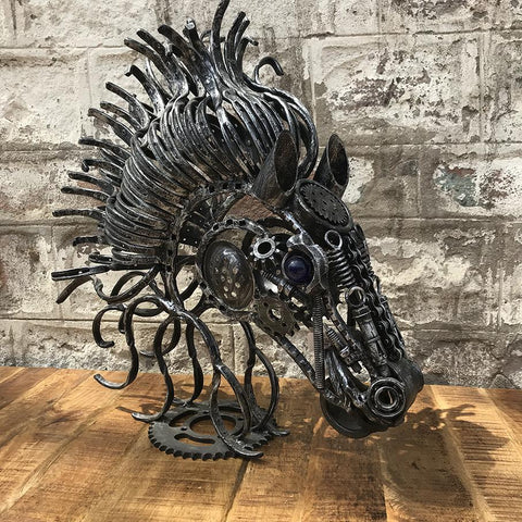Using scrap metal to create a horse head sculpture