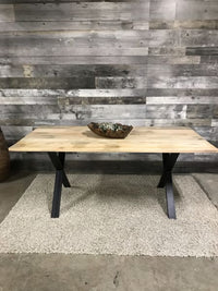 Exotic wood dining table with black metal X legs
