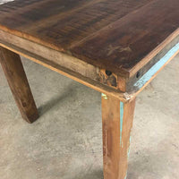 Reclaimed wood dining table with wooden legs