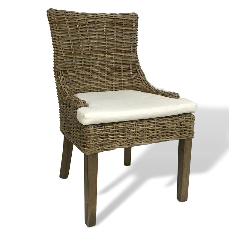 Wicker chair with white cushion - perfect for casual dining