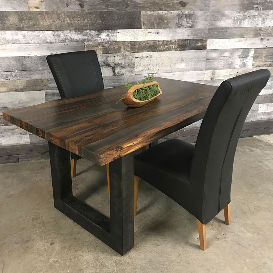 Small 63 inch grey rosewood table with black leather chairs