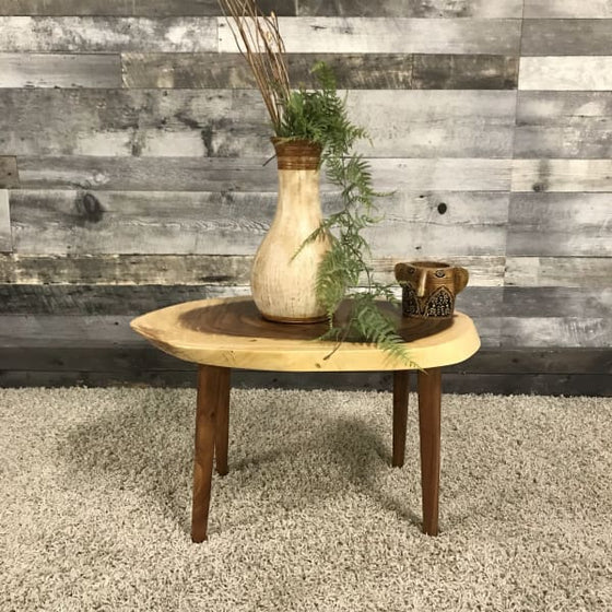 SMALL SUAR ROUND COFFEE TABLE ON 4 WOODEN LEGS - $289.00