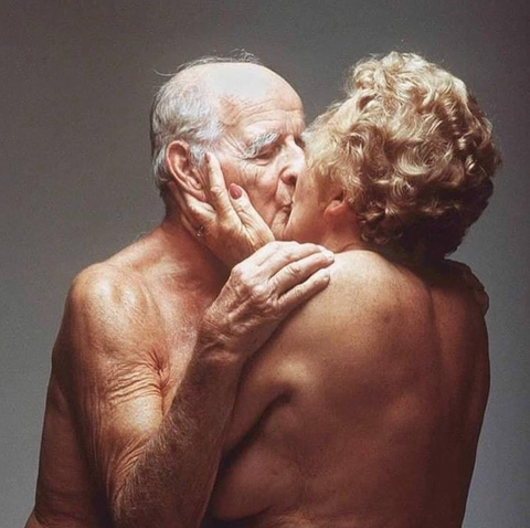 Elderly couple in passionate loving embrace