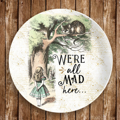 "Alice in Wonderland Dinnerware Plate - Cheshire Cat ""We're all mad here"". 10"" dinner plate made from revolutionary highly-durable ThermoSāf® Polymer which is significantly heavier than melamine dinnerware, making for a more quality feel. Made in the U.S.A."