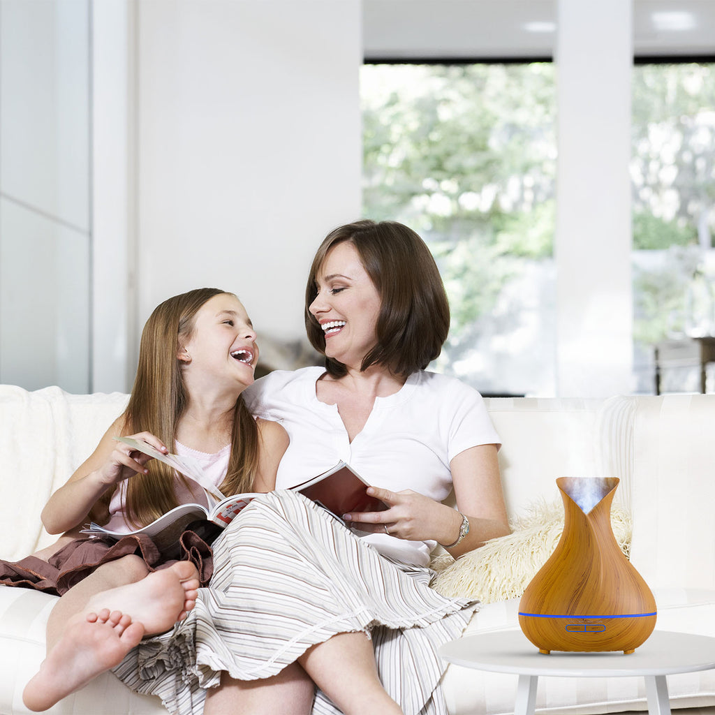 mom and daughter are relaxing on the couch