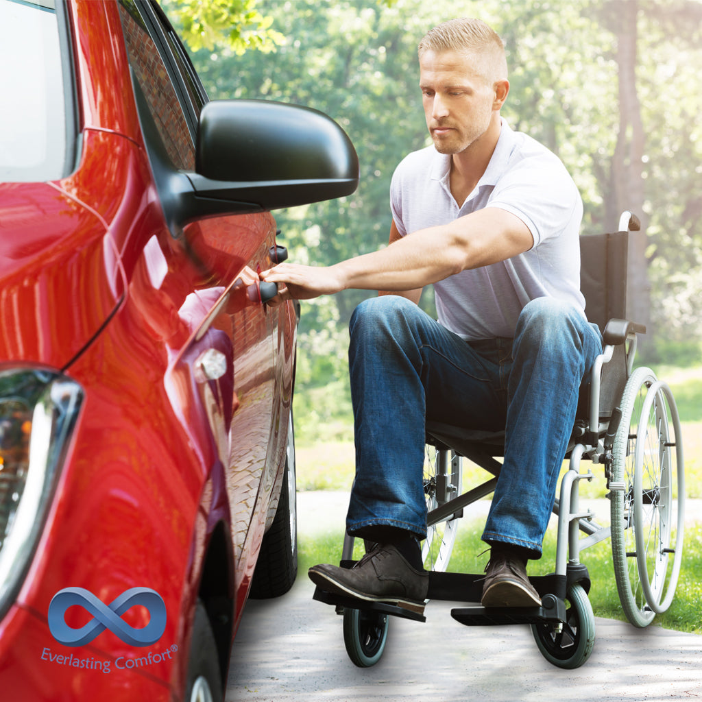 a person in a wheelchair gets behind the wheel