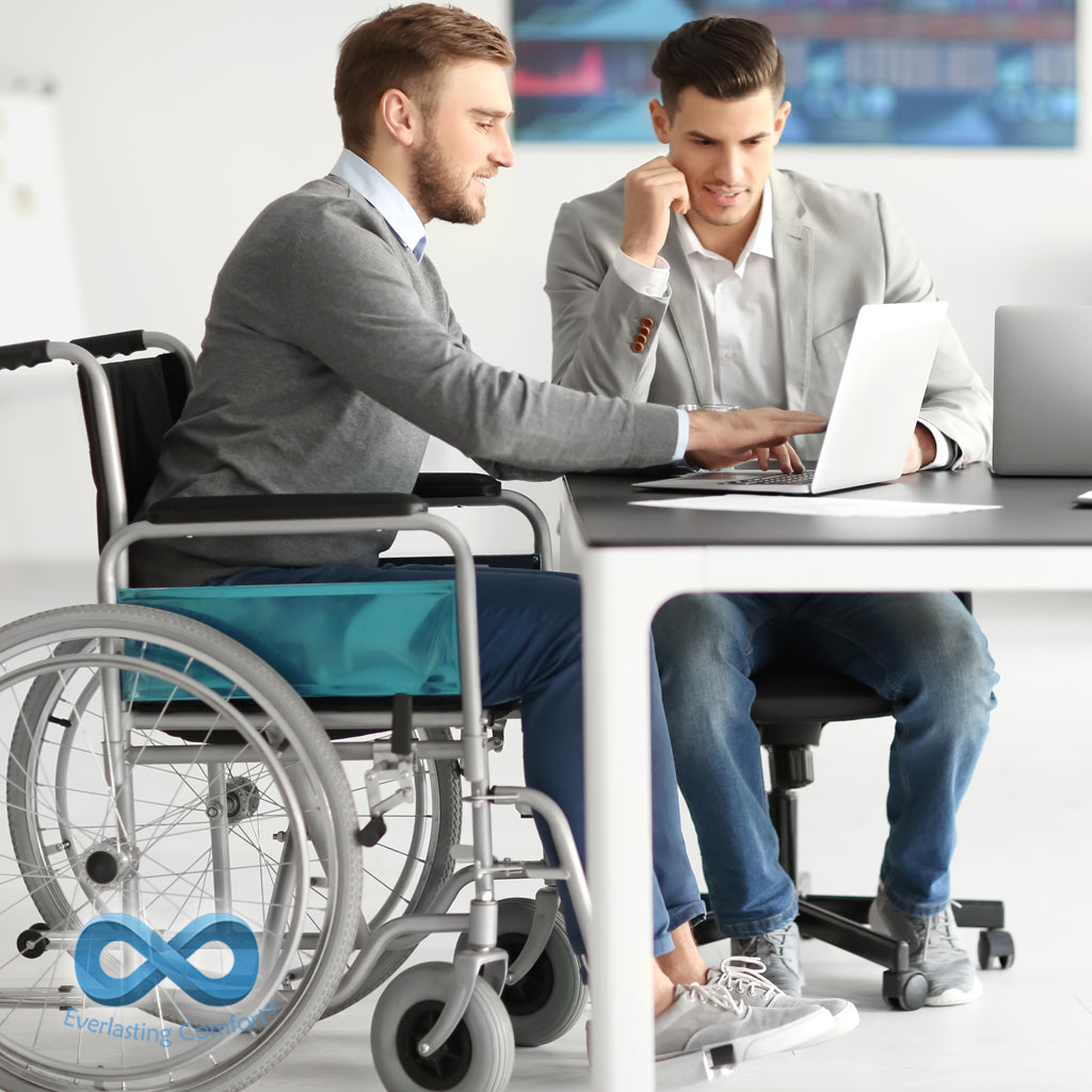 man in a wheelchair working in the office
