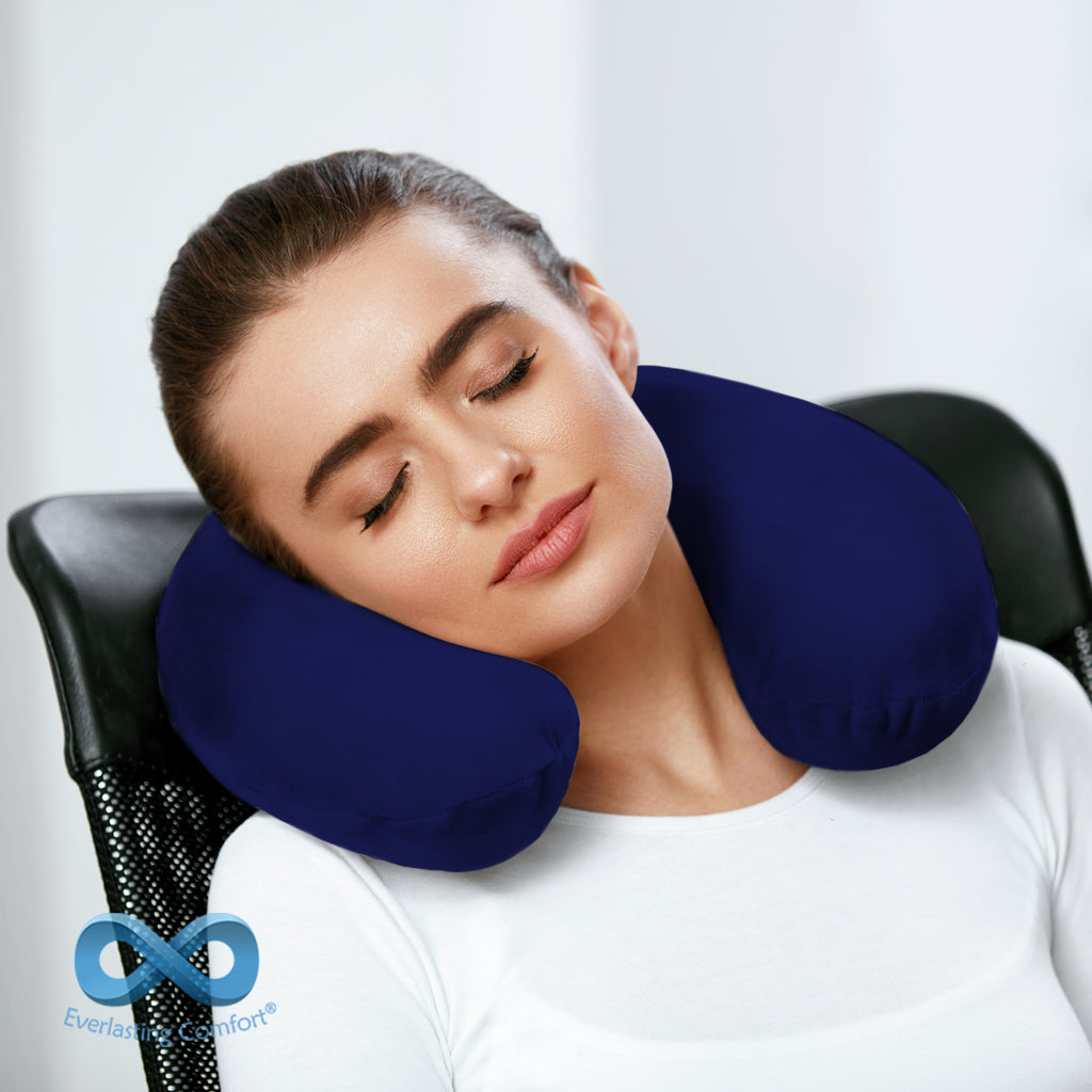 girl sleeping on a neck pillow