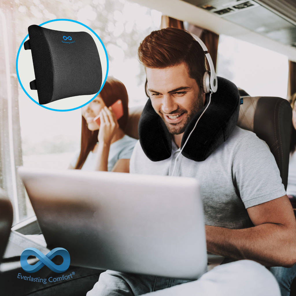 a girl sitting at a laptop on a bus