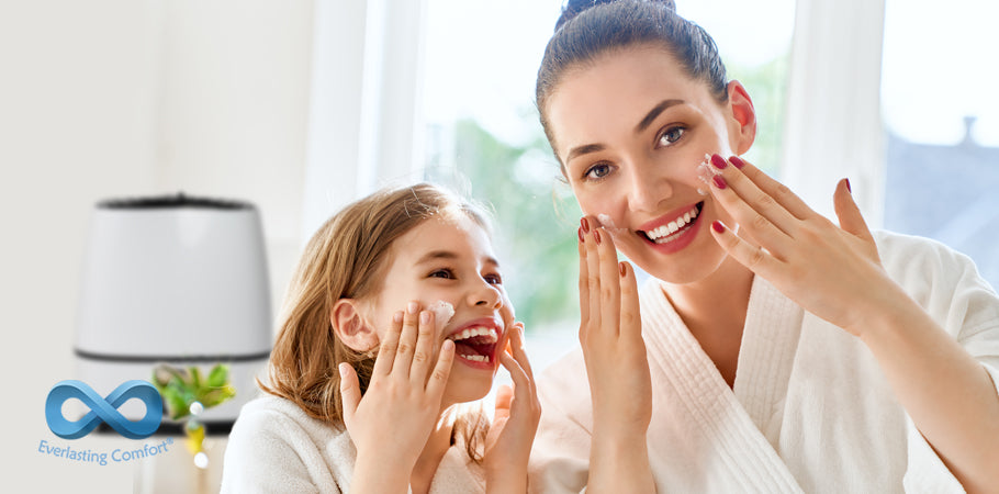mom and daughter laugh and smear face with cream