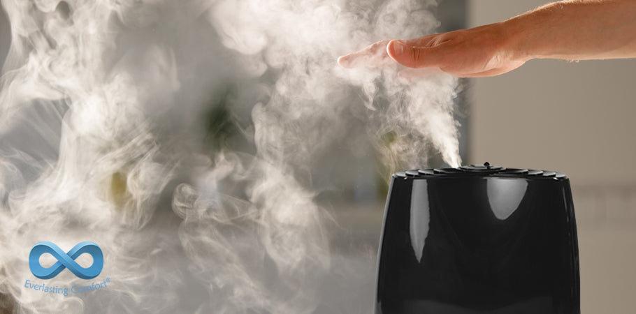 hand covers steam from humidifier