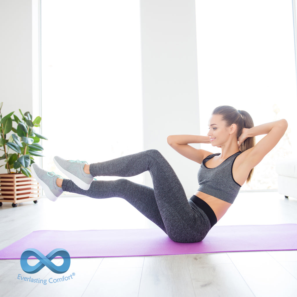 girl doing exercises on a sports mat
