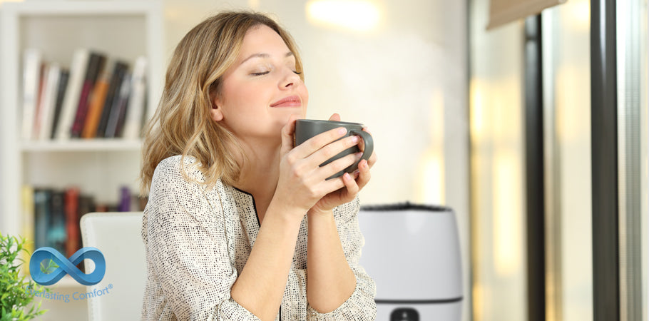 girl with closed eyes holds a mug in her hands