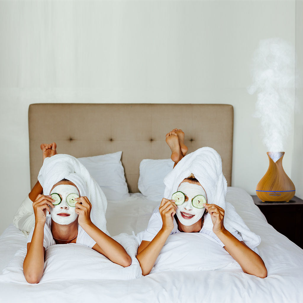 mom and daughter do spa treatments