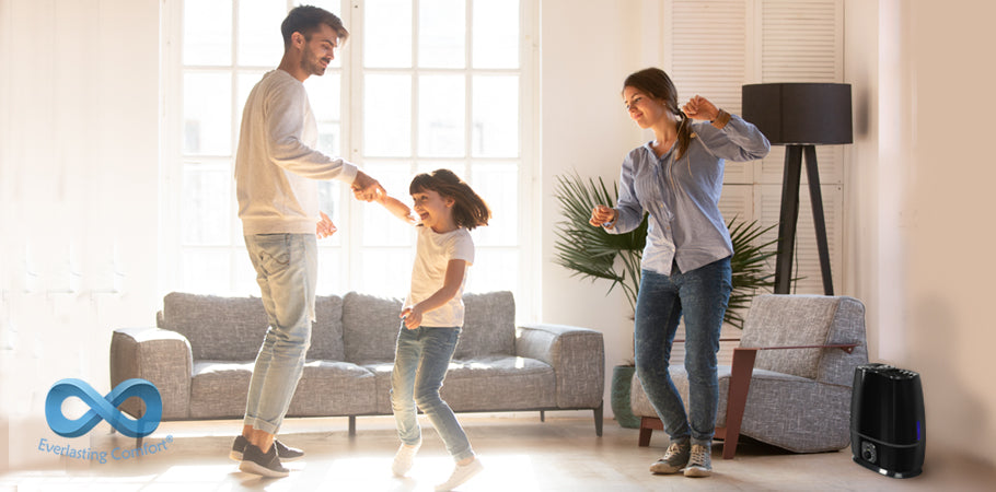 family dancing in a bright room