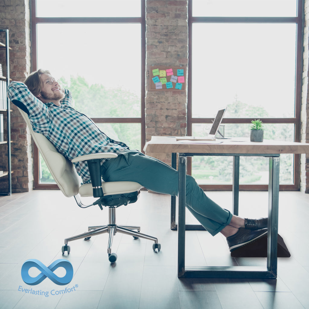 man resting in an office chair