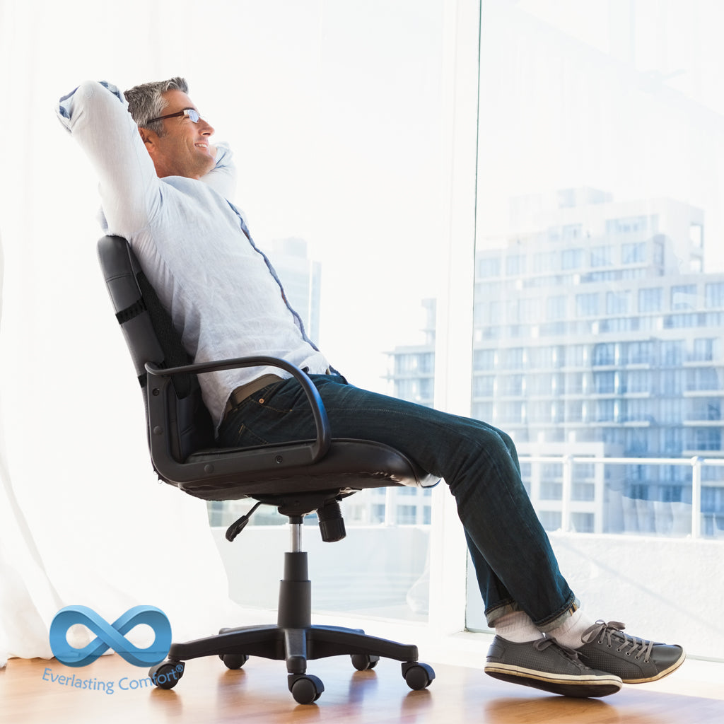 a man resting in an office chair