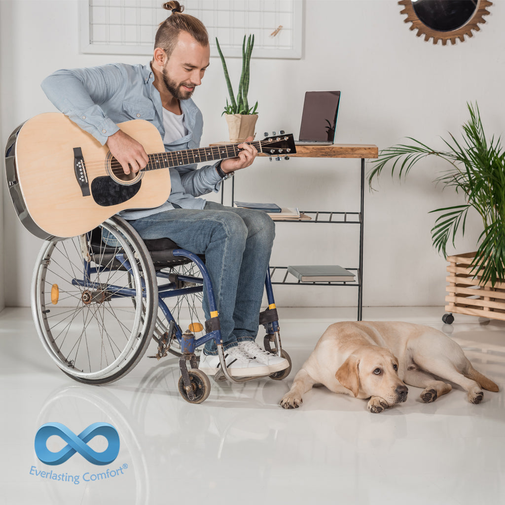 a young man in a wheelchair playing the guitar