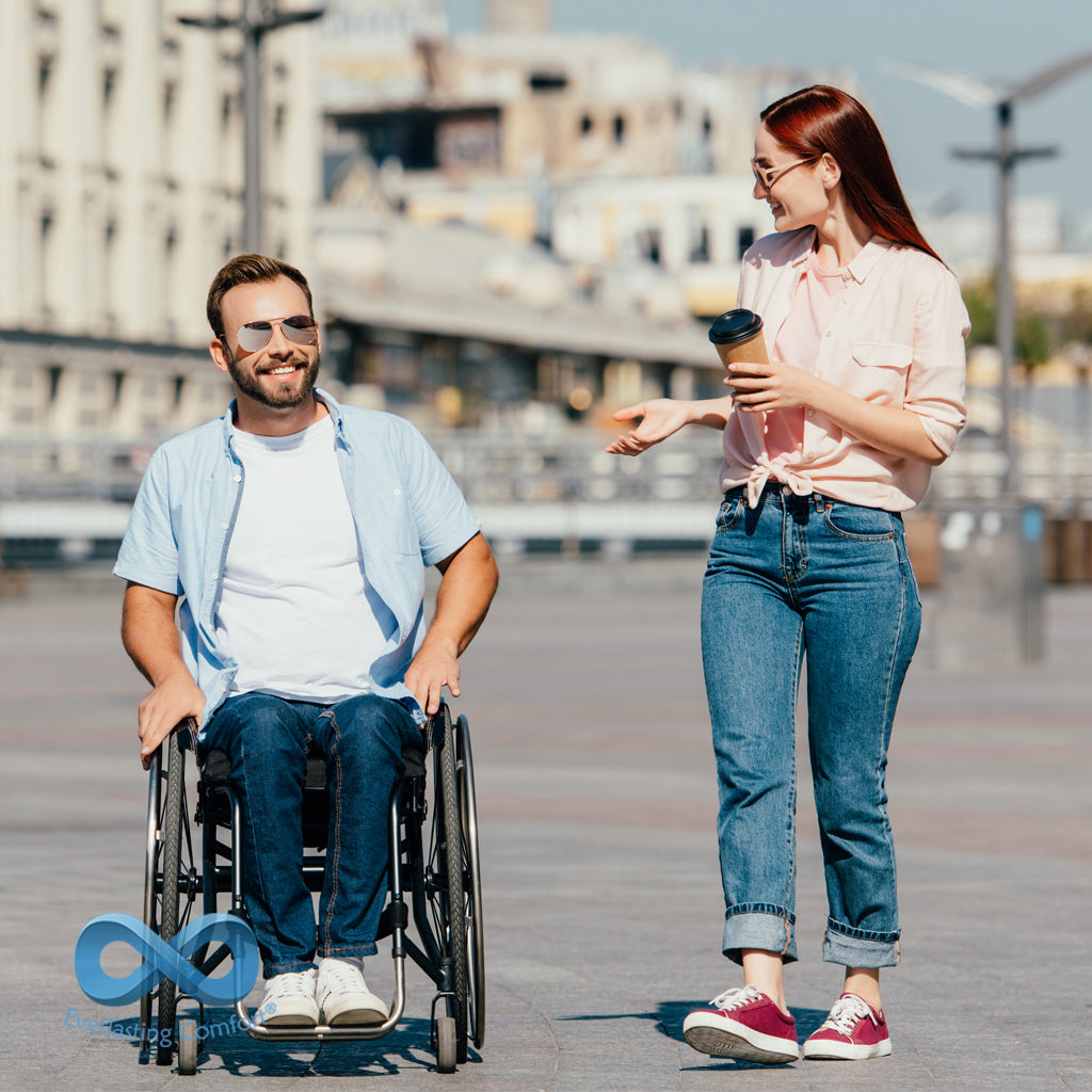 a young man in a wheelchair and a girl walking