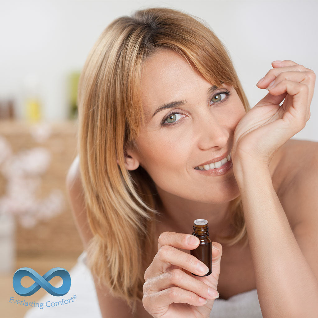 girl sniffing aroma oil